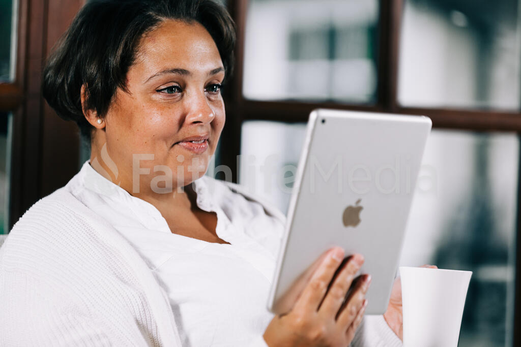 Woman Reading on a Tablet large preview