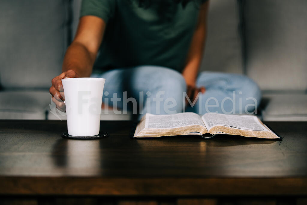 Woman Grabbing Her Bible for Devotions large preview