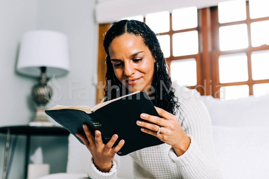 Woman Reading the Bible in Bed at Sunrise large preview