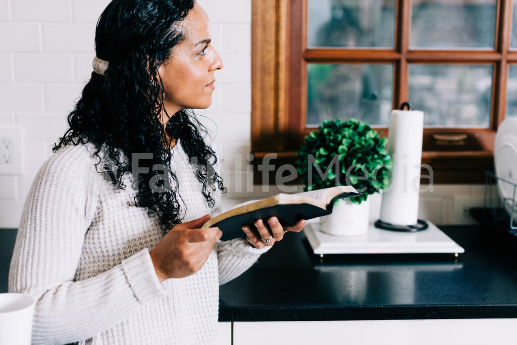 Woman Reading the Bible in the Kitchen large preview