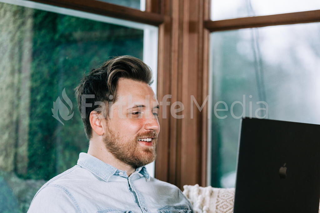 Man Working on a Laptop large preview