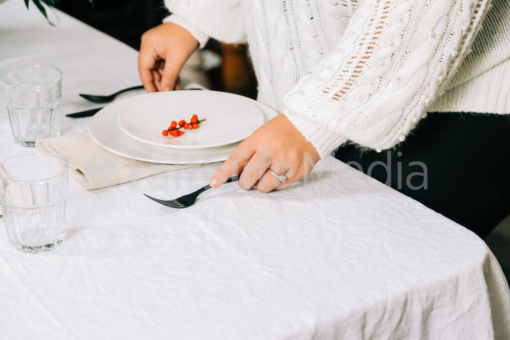 Woman Setting the Table for Christmas Dinner large preview