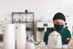 Barista Wearing a Mask and Making Coffee  image 2