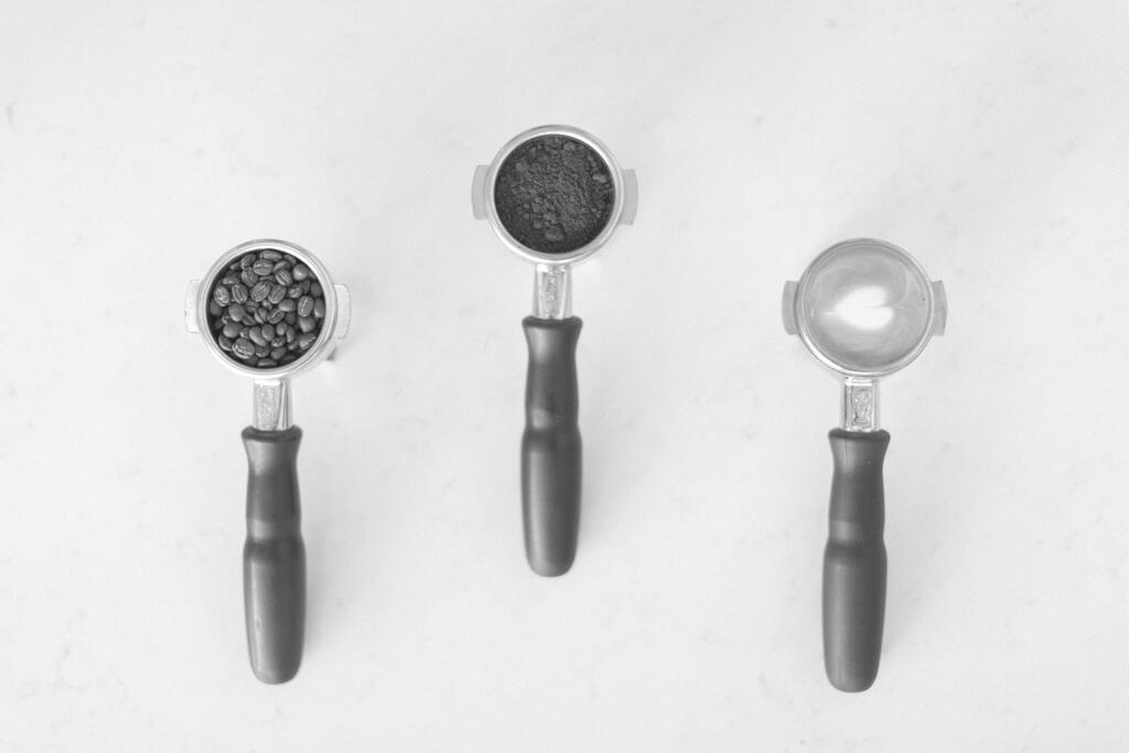 Three Portafilters with Coffee Beans, Coffee Grounds and Latte Art large preview
