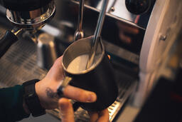 Barista Steaming Milk for a Latte  image 2