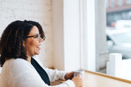 Woman Laughing with a Cup of Coffee  image 1