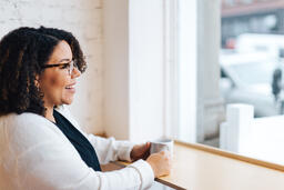 Woman Laughing with a Cup of Coffee  image 2