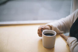 Woman Grasping Her Cup of Coffee  image 3