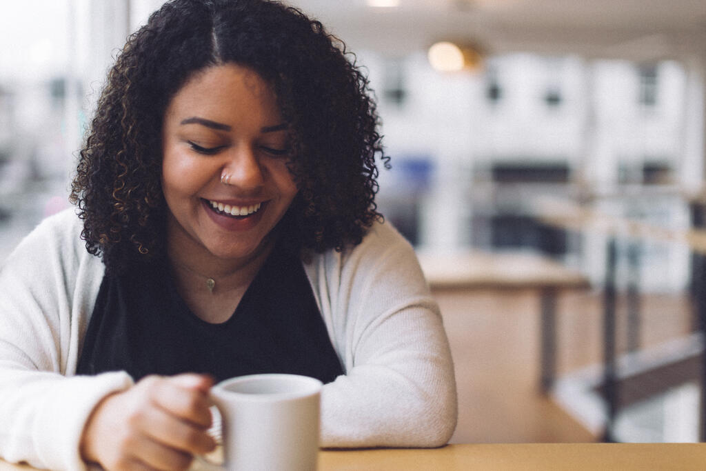 Woman Laughing with a Cup of Coffee large preview