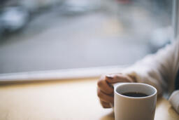 Woman Grasping Her Cup of Coffee  image 1