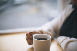 Woman Grasping Her Cup of Coffee  image 2