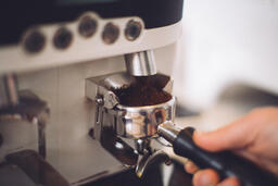 Barista Preparing to Pull Shots of Espresso with a Portafilter  image 1