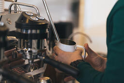 Barista Steaming Milk for a Latte  image 1