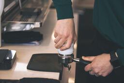 Barista Preparing to Pull Shots of Espresso with a Portafilter  image 5