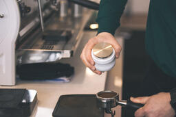 Barista Preparing to Pull Shots of Espresso with a Portafilter  image 1