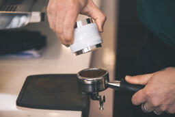 Barista Preparing to Pull Shots of Espresso with a Portafilter  image 3