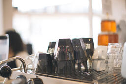 Cups Stacked on Top of an Espresso Machine  image 1