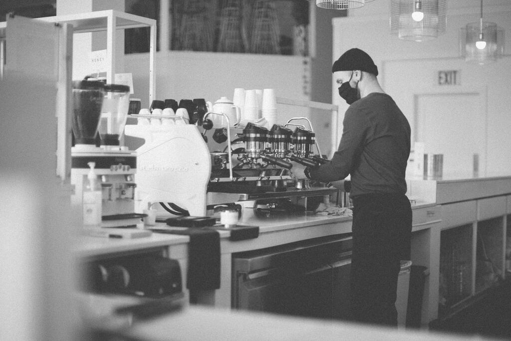 Barista Wearing a Mask and Making Coffee large preview