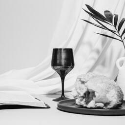 Communion Bread, Wine, Bible and Vase on Table  image 7