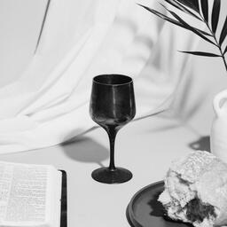 Communion Bread, Wine, Bible and Vase on Table  image 10