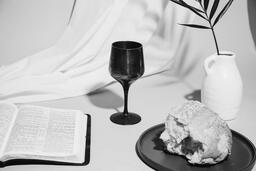 Communion Bread, Wine, Bible and Vase on Table  image 1