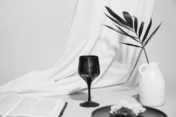 Communion Bread, Wine, Bible and Vase on Table  image 11