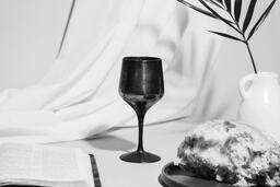 Communion Bread, Wine, Bible and Vase on Table  image 8