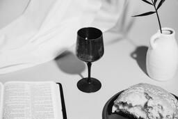 Communion Bread, Wine, Bible and Vase on Table  image 6