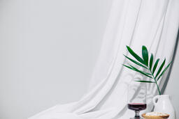 Communion Next to Palm Branches  image 1