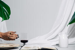 Wafers, Wine, and Bible on Table  image 2