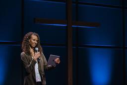Female Pastor on Stage  image 1