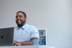 Man Working on Laptop in Office  image 3