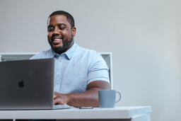 Man Working on Laptop in Office  image 4
