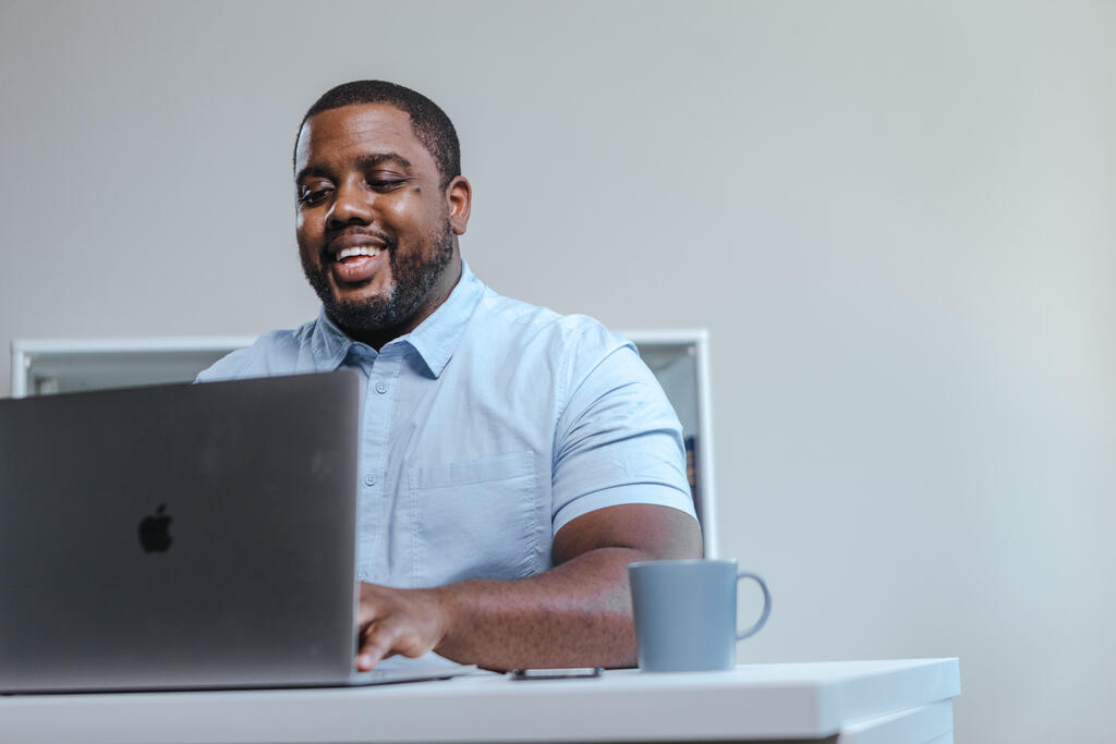 Man Working on Laptop in Office large preview