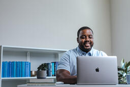 Man Working on Laptop in Office  image 2