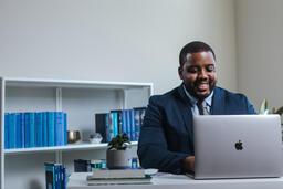 Man Working on Laptop  image 1
