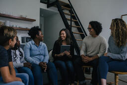 Woman Teaching Small Group of People  image 2