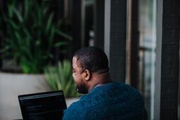 Man Facing Away Working on Laptop  image 13