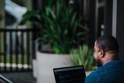 Man Facing Away Working on Laptop  image 12