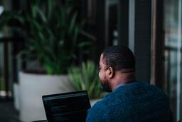Man Facing Away Working on Laptop  image 18