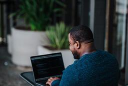 Man Facing Away Working on Laptop  image 16