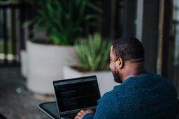 Man Facing Away Working on Laptop  image 10