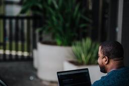 Man Facing Away Working on Laptop  image 17