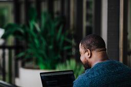 Man Facing Away Working on Laptop  image 9