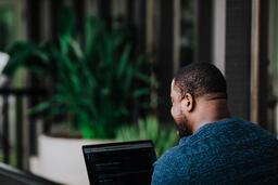 Man Facing Away Working on Laptop  image 11