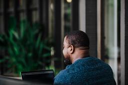Man Facing Away Working on Laptop  image 19
