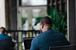Man Facing Away Working on Laptop  image 5