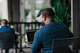 Man Facing Away Working on Laptop  image 2