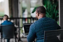 Man Facing Away Working on Laptop  image 15
