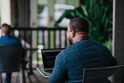 Man Facing Away Working on Laptop  image 14